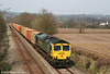 The (nowadays) unusual sight of a container train on the North & West route. 66587 briefly disturbs the tranquility of a very pleasant spring afternoon at Llanover with new flow 4K46/4V46, 0910 Garston/1109 Crewe Basford Hall to Wentloog on 10th April 2010.