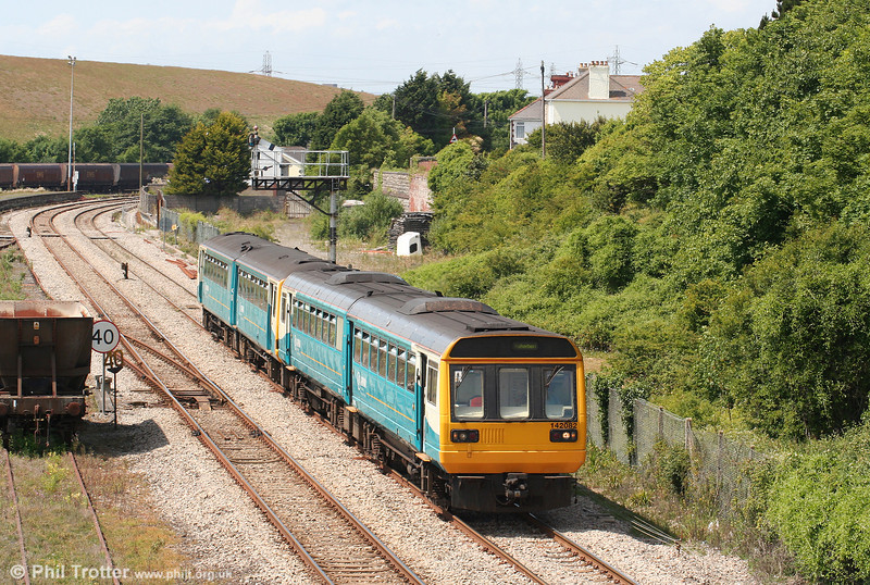 142082 and 143605 pass Aberthaw with the 1407 Bridgend to Treherbert on 27th June 2010.