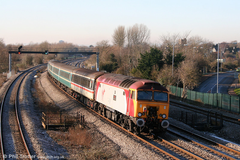 57303 'Alan Tracy' brings up the rear of 2U14, 1102 Taunton to Cardiff Central at Undy on 4th January 2010.