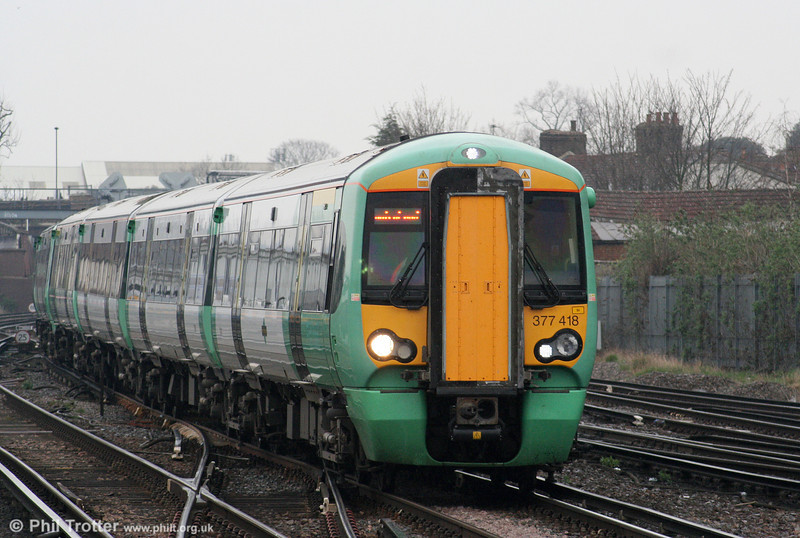 The 377/4s are outer suburban units. 377418 is, again, at East Croydon on 7th April 2010.
