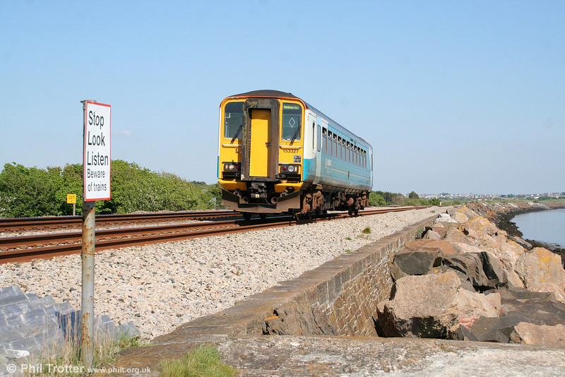153327 at Cefn Padrig Bay with the 1605 Swansea to Pembroke Dock on 22nd May 2010.
