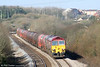 59203 'Vale of Pickering' and 66165 begin the slow climb up Stormy Bank with 6B13, 0505 Robeston to Westerleigh on 27th March 2010.