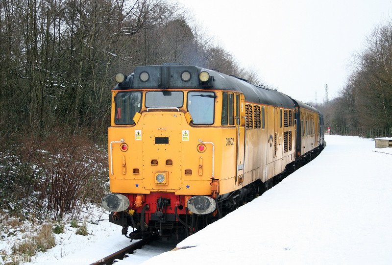NR 31602 'Driver Dave Green' at the rear of test train 2Z08 at Pontarddulais on 6th January 2010. Unfortunately, road conditions prevented any further shots of this working!
