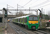 The class 321/4s are now split between several TOCs, 321411-417 with London Midland. Hotly pursued by a Pendolino, 321412 approaches Watford Junction forming the 1156 Tring to London Euston on 20th March 2010.