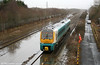 175008 passes over the flooded formation at Trostre, forming the (restarted, following an incident in Herefordshire - ?) 0830 Manchester Piccadilly to Milford Haven on 16th January 2010.