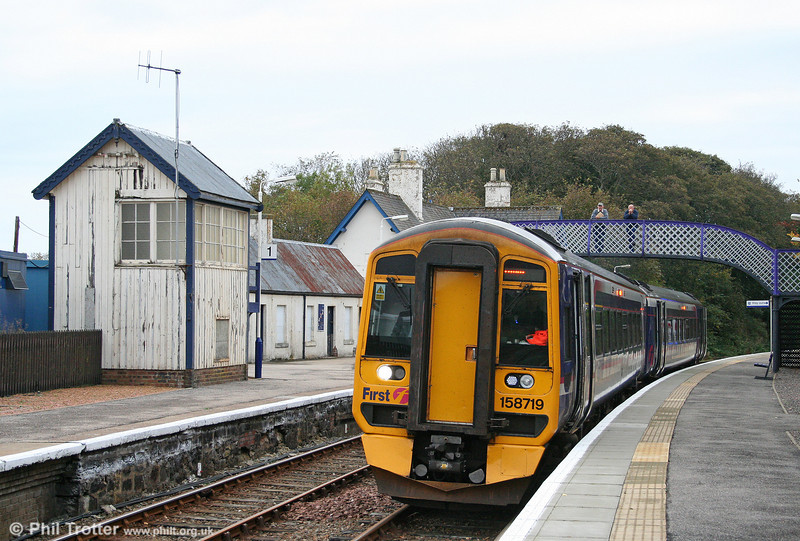 With the former 'Helmsdale South' signal box alongside, 158719 waits at Helmsdale forming the 0706 Inverness to Wick on 14th October 2010.
