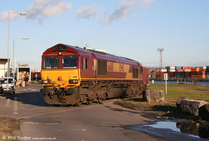 66118 crosses the road to leave Barry Docks with 6O96, 1515 Barry Docks to Swansea Burrows Sidings on 30th January 2010.