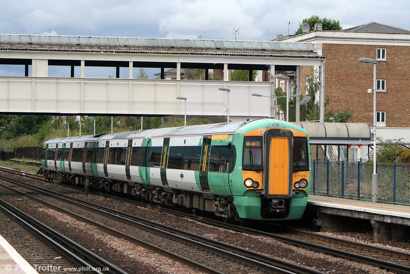 377210 calls at Kensington (Olympia) forming the 1313 Milton Keynes Central to South Croydon on 7th August 2010.