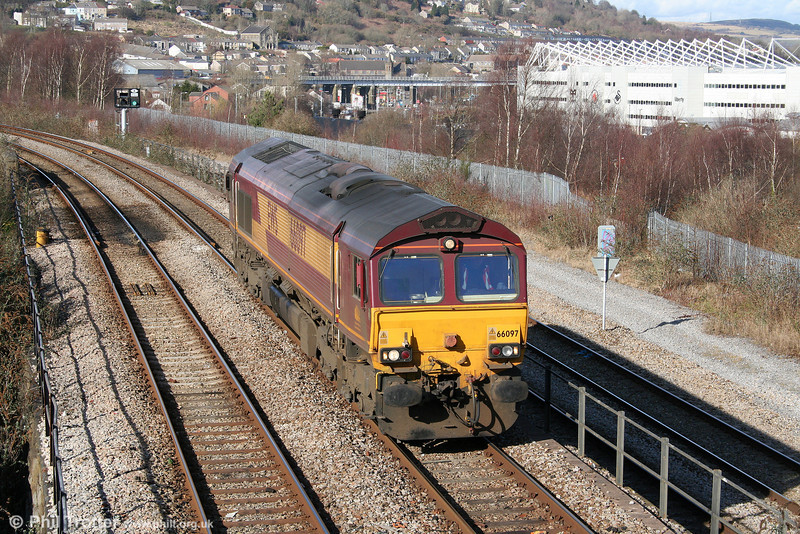 66097 passes Landore running as 0Z88, Margam to Swansea ready to collect the ECS of the incoming 'St. David's Day Cathedrals Express' on 1st March 2010. (The loco had reversed at Loop West to make way for an incoming FGW HST).