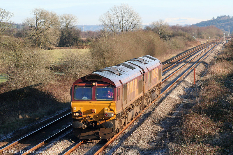 66207 and 66083 are seen at Nantyrhebog running as 0A11, 1045 Margam to Robeston, ready to work the evening's 6A11 to Theale on 1st January 2010.