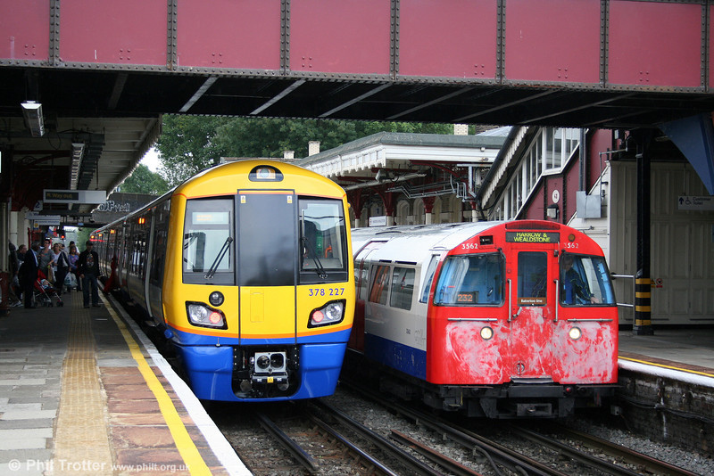 378227 contrasts with Bakerloo Line 1972 stock no. 3562 at Harrow & Wealdstone on 7th August 2010.