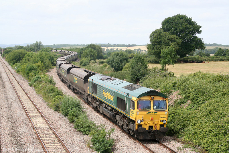 66549 is seen at Llandevenny with 4Z37, 1220 Aberthaw PS to Stoke Gifford coal empties on 8th July 2010. This is the return working of new flow 6Z37, 1830 Killoch Colliery to Aberthaw Power Station.