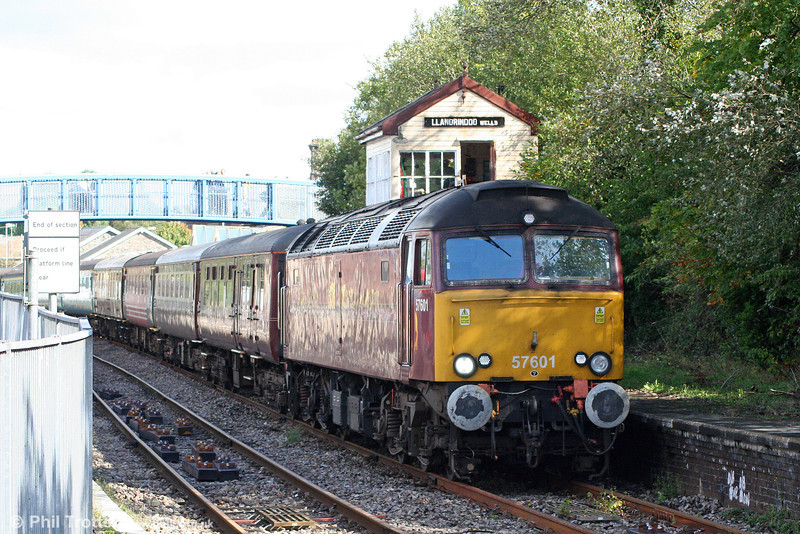 57601 again at Llandrindod Wells with 1Z15/51, 0600 York and Manchester Victoria to Cardiff Central, 'The Heart of Wales Statesman' on 11th September 2010. The signal box is non-operational and is open as a museum.