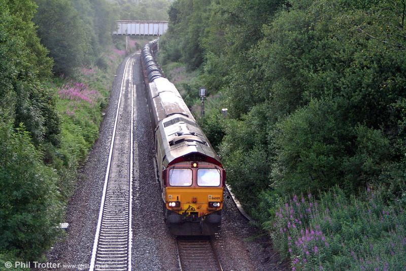 66089 heads west through Llangyfelach with 6B26, 0640 Margam to Trostre on 16th July 2010.