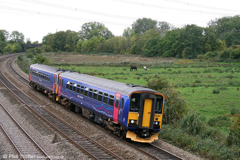 153380 and 153305 pass Duffryn forming the 1300 Cardiff Central to Taunton on 2nd October 2010.