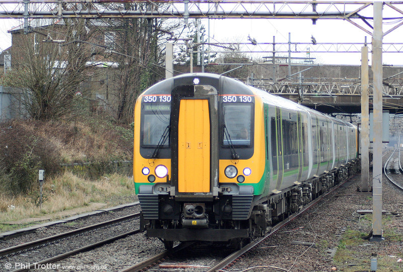 LM 350130 speeds through Watford Junction forming the 1125 Northampton to London Euston on 20th March 2010.