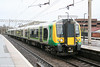 350238 calls at Watford Junction forming the 1026 Tring to London Euston on 20th March 2010.