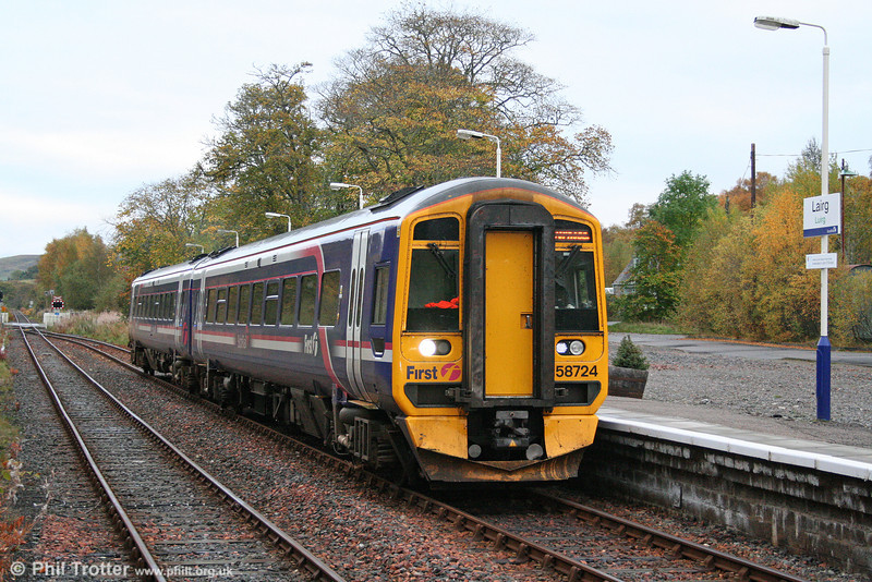 158724 calls at a cold and autumnal Lairg, forming the 0620 Wick to Inverness on 14th October 2010.
