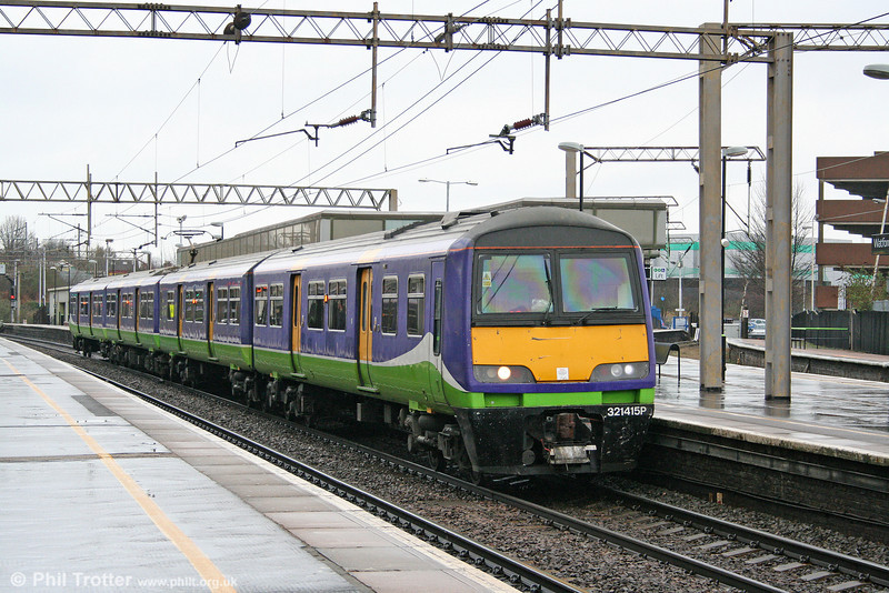 Still carrying the now defunct Silverlink livery, LM 321415 calls at Watford Junction forming the 1056 Tring to London Euston on 20th March 2010.