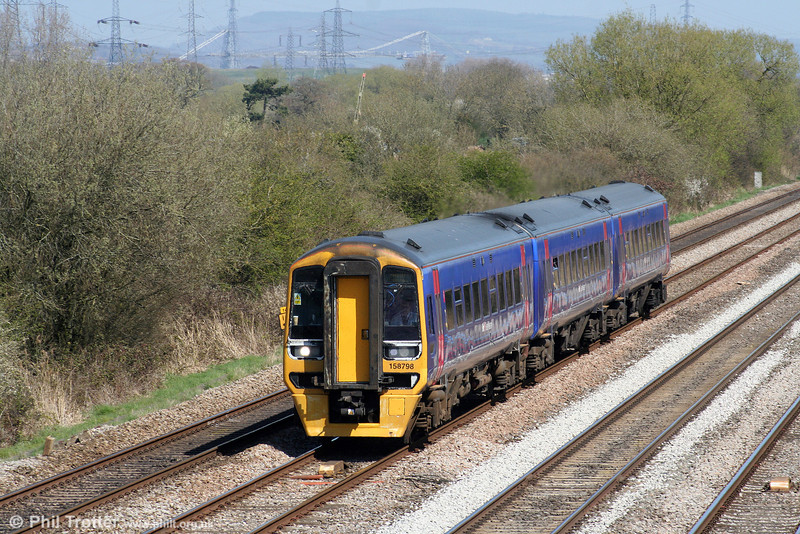 FGW's sole 'proper' three car class 158, 158798 passes Coedkernew forming the 1023 Portsmouth Harbour to Cardiff Central on 17th April 2010.
