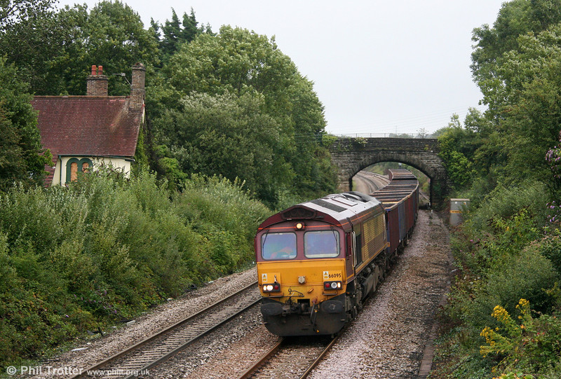66095 is seen at Pyle with 6O96, 1615 Barry Docks to Swansea Burrows empty MEAs on 21st August 2010. A sign of the times is the boarded up Crown Inn, once the stationmaster's house and office and where inquiries into local mining accidents were held.