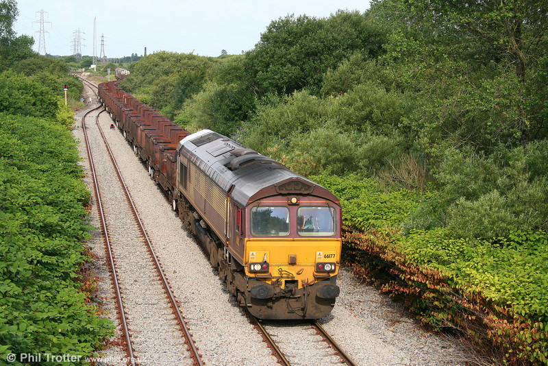White roofed (well, sort of...) 66177 pulls away from Trostre with 6B03, 0910 Trostre to Llanwern on 17th July 2010.