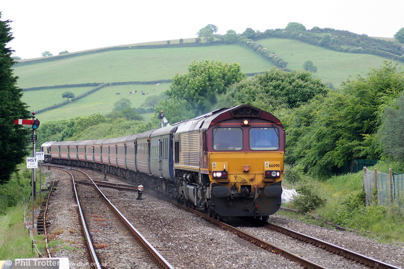 66090 heads through Ferryside with Compass Tours 1Z60, 1556 Carmarthen to Holyhead, the return 'Heart of Wales Scenic Rambler' on 5th June 2010.