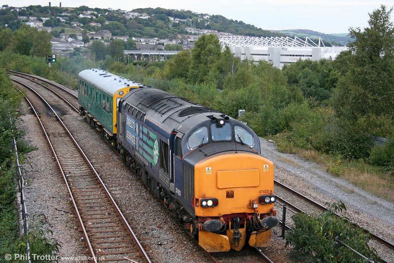 DRS 37423 'Spirit of the Lakes' and Inspection Saloon 975025 'Caroline' approach Swansea, having reversed at Loop West with 2Z01, 0931 Ealing Broadway to Swansea on 21st September 2010.