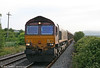 66213 heads through Llangennech with 6B26, 0640 Margam to Trostre on 6th July 2010.