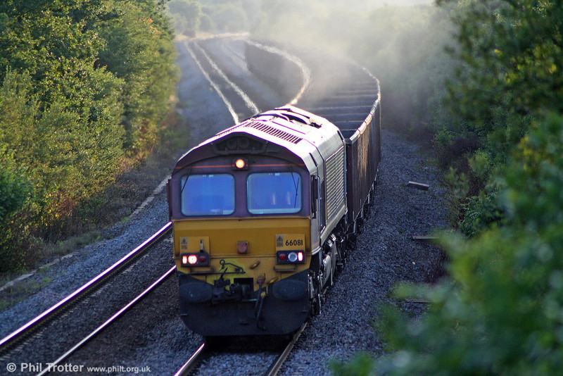 66081 climbs Stormy Bank at sunset with 6C96, 1958 Margam to Cwmbargoed Opencast Colliery on 23rd July 2010.