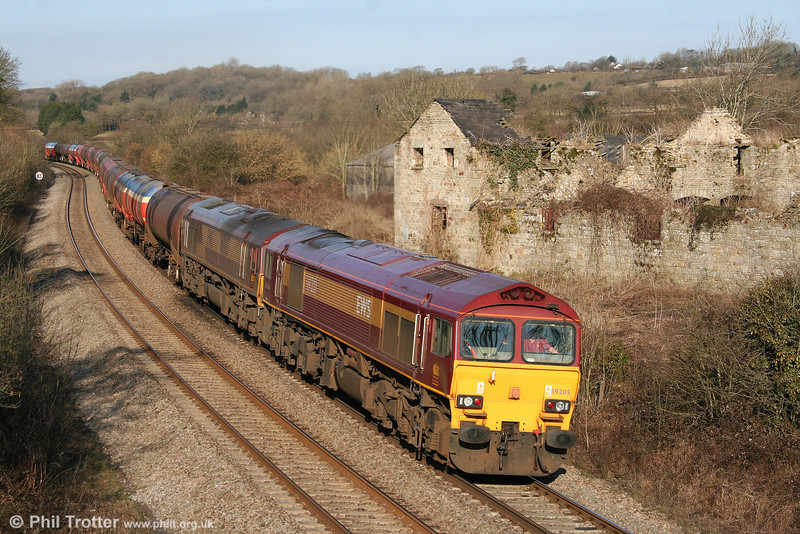 59205 'L Keith McNair' and 66067 pass Llangewydd with 6B13, 0505 Robeston to Westerleigh on 13th March 2010.
