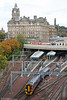 Edinburgh's magnificent Balmoral Hotel was built by the North British Railway in 1902, and lost its original name, the North British Hotel during the 1980s. 158741 departs from Edinburgh Waverley on 17th October 2010.