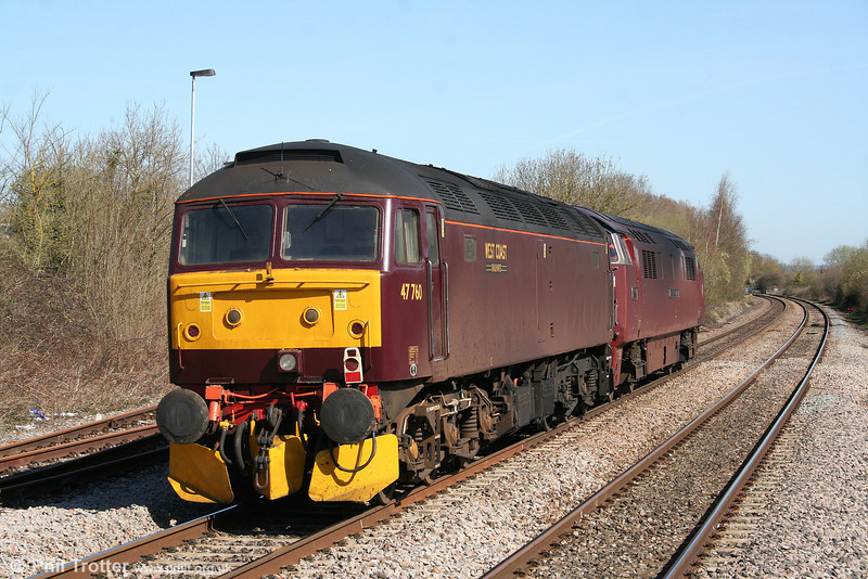 West Coast's 47760 is dragged through Yate by D1015 'Western Champion' as the support to the steam-hauled 'Great Britain III' railtour, running as 0Z86, 1003 Bristol Barton Hill to Preston on 8th April 2010.
