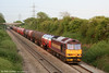 60039 descends Stormy bank at sunset with 6B47, 1722 Westerleigh to Robeston on 21st May 2010.