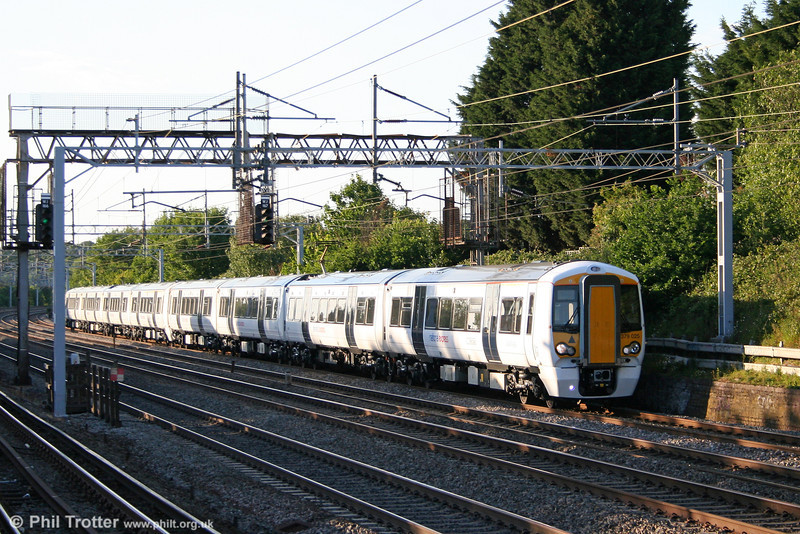 National Express East Anglia 379025 leads 379004 working 5Z76, Rugby to Ilford Depot at Carpenders Park on 31st May 2011. The brand new pair were heading for Ilford following test running on the WCML.