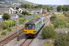 143624 and a class 153 approach Pembrey & Burry Port forming the midday Swansea to Pembroke Dock on 29th August 2011.