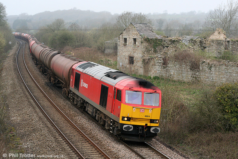 DB red 60011 passes Llangewydd with 6B13, 0505 Robeston to Westerleigh on 2nd April 2011.