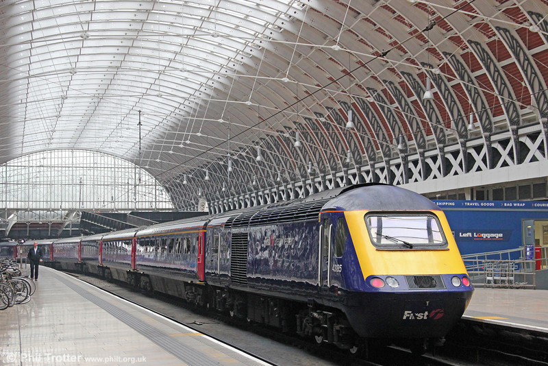 The £35M restoration of London Paddington's 'Span Four' dating from 1916 and which covers platforms 9-12 has been completed and presents a bright and airy atmosphere. The appropriately named 43185 'Great Western' stands beneath the restored roof on 27th October 2011.