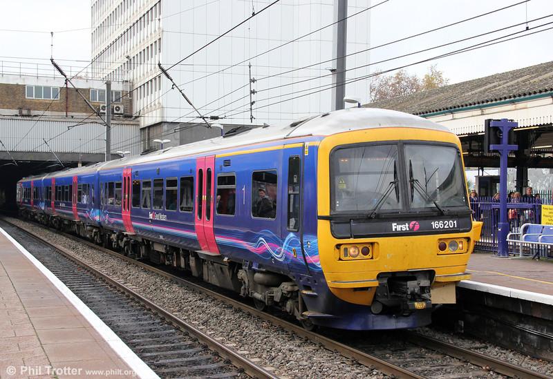 166201 calls at Ealing Broadway, forming the 1048 Reading to London Paddington on 12th November 2011.