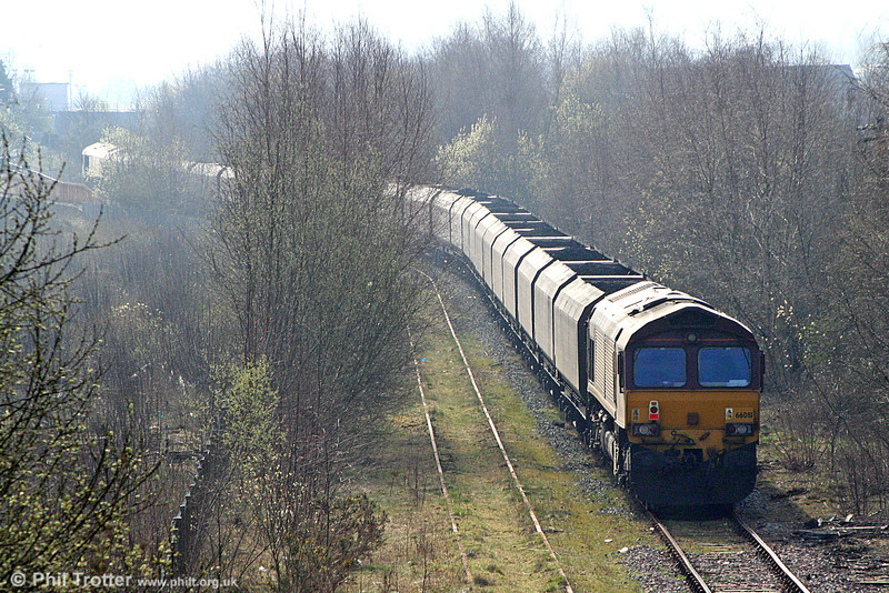 66081 waits at the rear of 6C45, 1054 Tower to Aberthaw Power Station at Aberdare on 26th March 2011. These trains have been topped and tailed in recent months due to the loop at Tower being out of use.