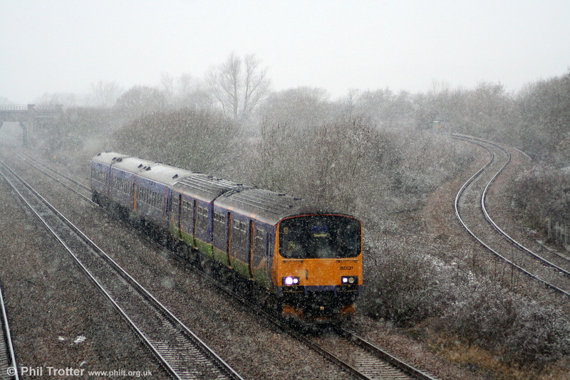 Class 150/1s will become more common in south Wales and the west during 2011, with FGW receiving several from other TOCs. 150121 leads the 1200 Cardiff Central to Taunton through Llandevenny on 3rd January 2011. Nice day for photography...