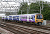 Northern 323235 approaches Crewe forming the 1604 from Manchester Piccadilly on 2nd August 2011.