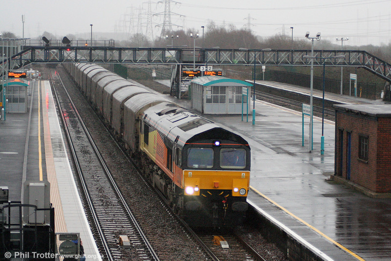 66844 (formerly 66409) passes Severn Tunnel Junction with 6V56, 0321 Dollands Moor to Llanwern on 15th January 2011.