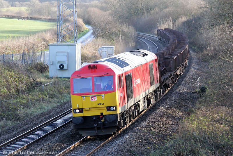 Steel traffic between Margam and Llanwern has thinned out again of late, with the closure of the hot rolling mill at the latter steelworks. 'Supertug' 60054 passes Llangewydd with 6H24, 0951 Llanwern to Margam return empties on 7th December 2011.