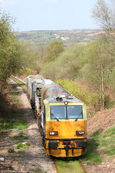 Network Rail's MPV DR98909+DR98959 passes Garnant on the Gwaun Cae Gurwen branch with weed killing train 6Z10 from Margam on 17th April 2011.