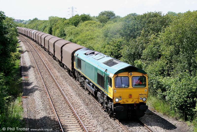 The class 66 swap-around continues... 66575 is one of five former Freightliner 66/5s which have passed to Colas to replace its 66/8s which are in turn being transferred to GBRf. Previously stored at Southampton, 66575 begins the climb to Stormy Summit with 6Z78, 1415 Margam to Dollands Moor on 19th June 2011.