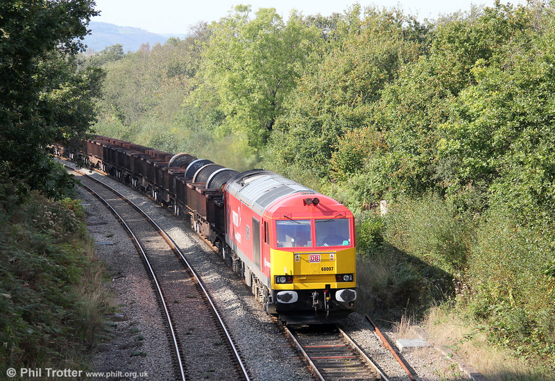60007 'The Spirit of Tom Kendell' returns through Alltygraban with Trostre to Margam empties on 1st October 2011. Note the returned damaged coils at the front; back into the pot perhaps?