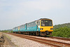 143616 passes Pwll with what appears to be a route learning train on 1st May 2011.