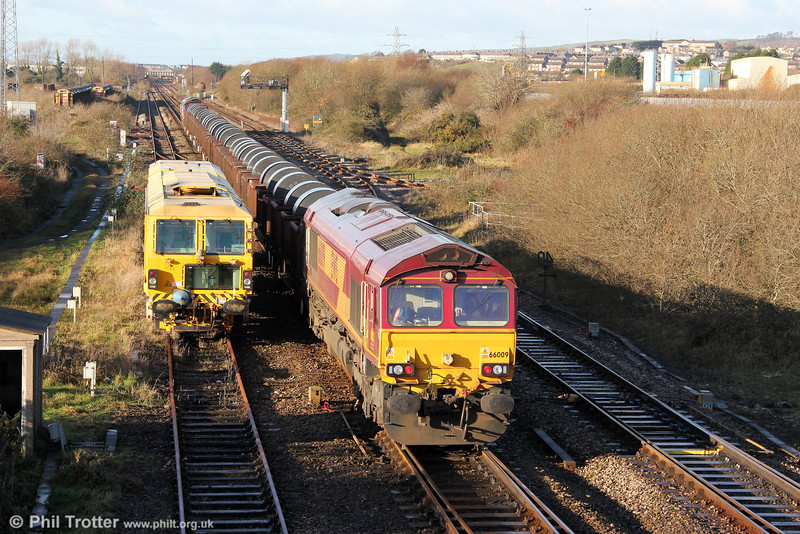 To facilitate a reversal into Trostre works, 66009 brings up the rear of 6B11, 1015 Margam to Trostre at Llandeilo Junction on 18th December 2011.
