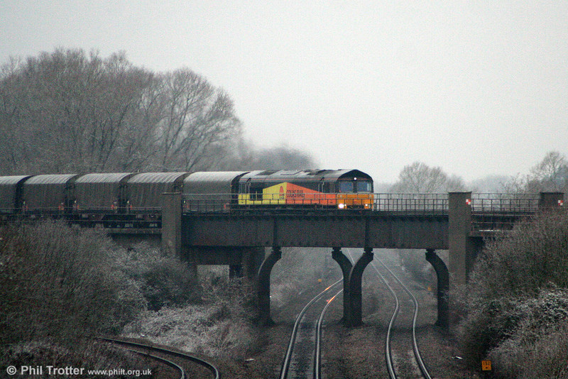 Colas 66844 crosses Bishton Flyover at the head of 6O55, 1348 Llanwern to Dollands Moor on 3rd January 2011.